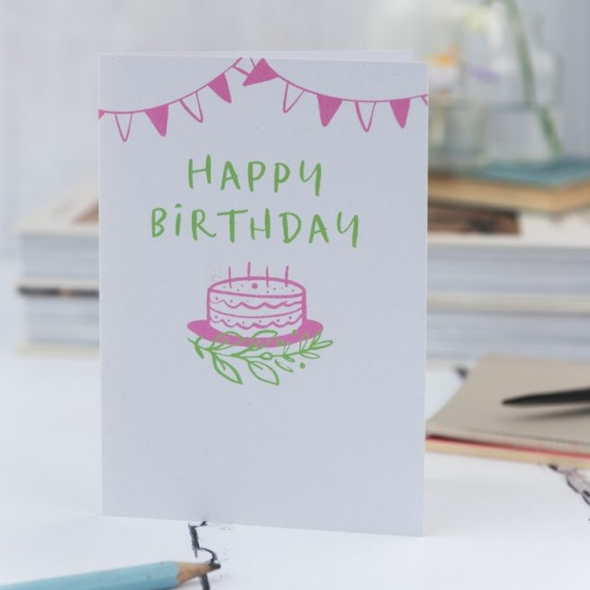 happy birthday card with pink bunting and birthday cake illustration