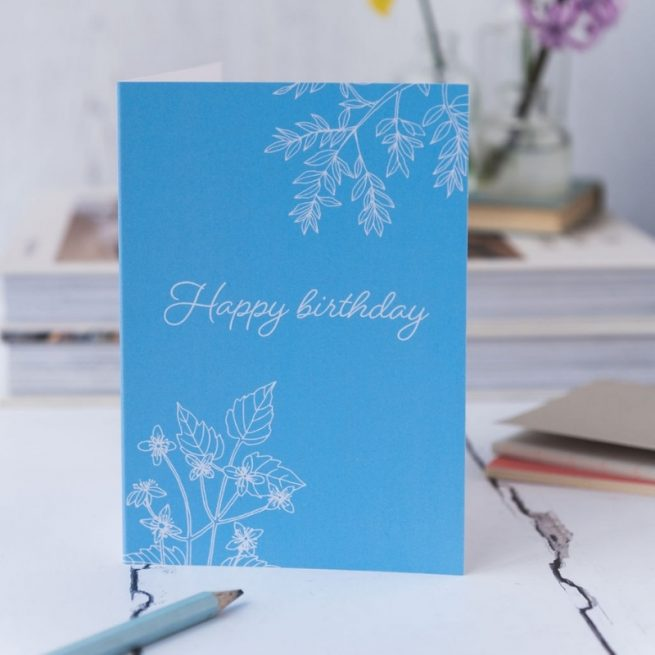 Happy Birthday card blue background white writing